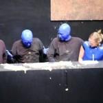 Blue Man having a little accident